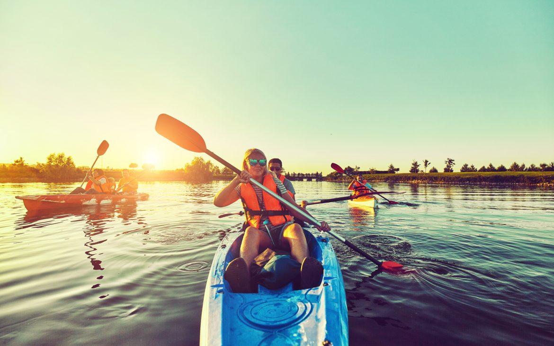 Children on canoe, Family on kayak ride.