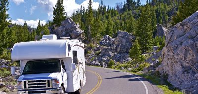 RV takes a curve in Mountains.
