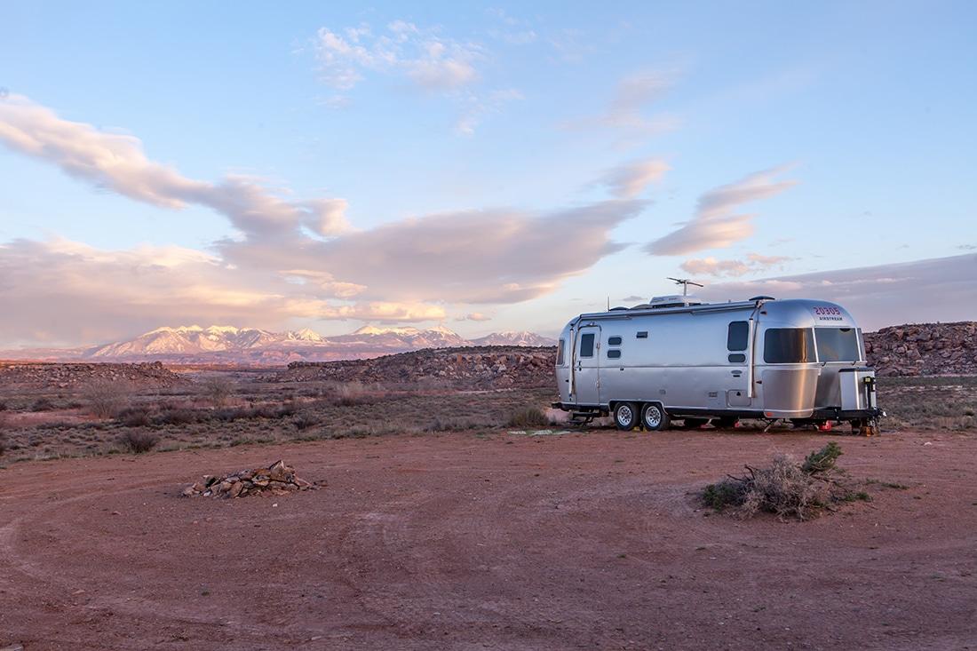 Airstream in a bleak desert landscape.
