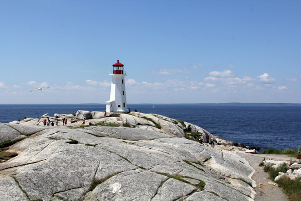 """The famous lighthouse at Peggy's Cove, sitting atop """"erratic"""" rock formations"""