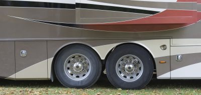 Motorhome parked in campground two tires