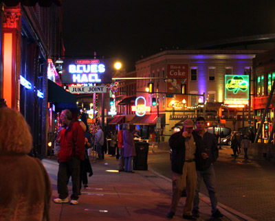 Crowds along Beale Street hear music coming from every door & window