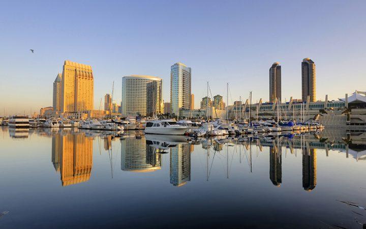 San Diego's downtown skyline reflected on San Diego Bay.