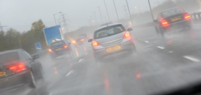 Cars driving in rain on highway