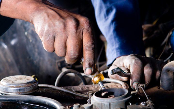 mechanic working on a vehicle