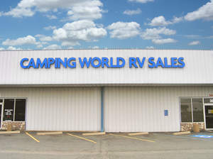 Camping World RV Sales storefront and empty parking lot
