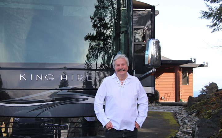 Man Standing in front of King Aire Motorhome