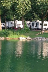 Timberline Valley RV Resort - lakeside view of RVs