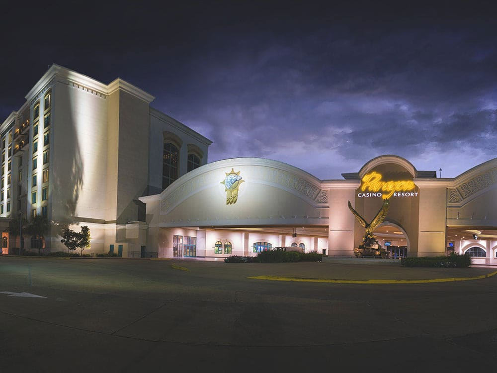 Beautiful Paragon Casino at night with dark clouds in the background