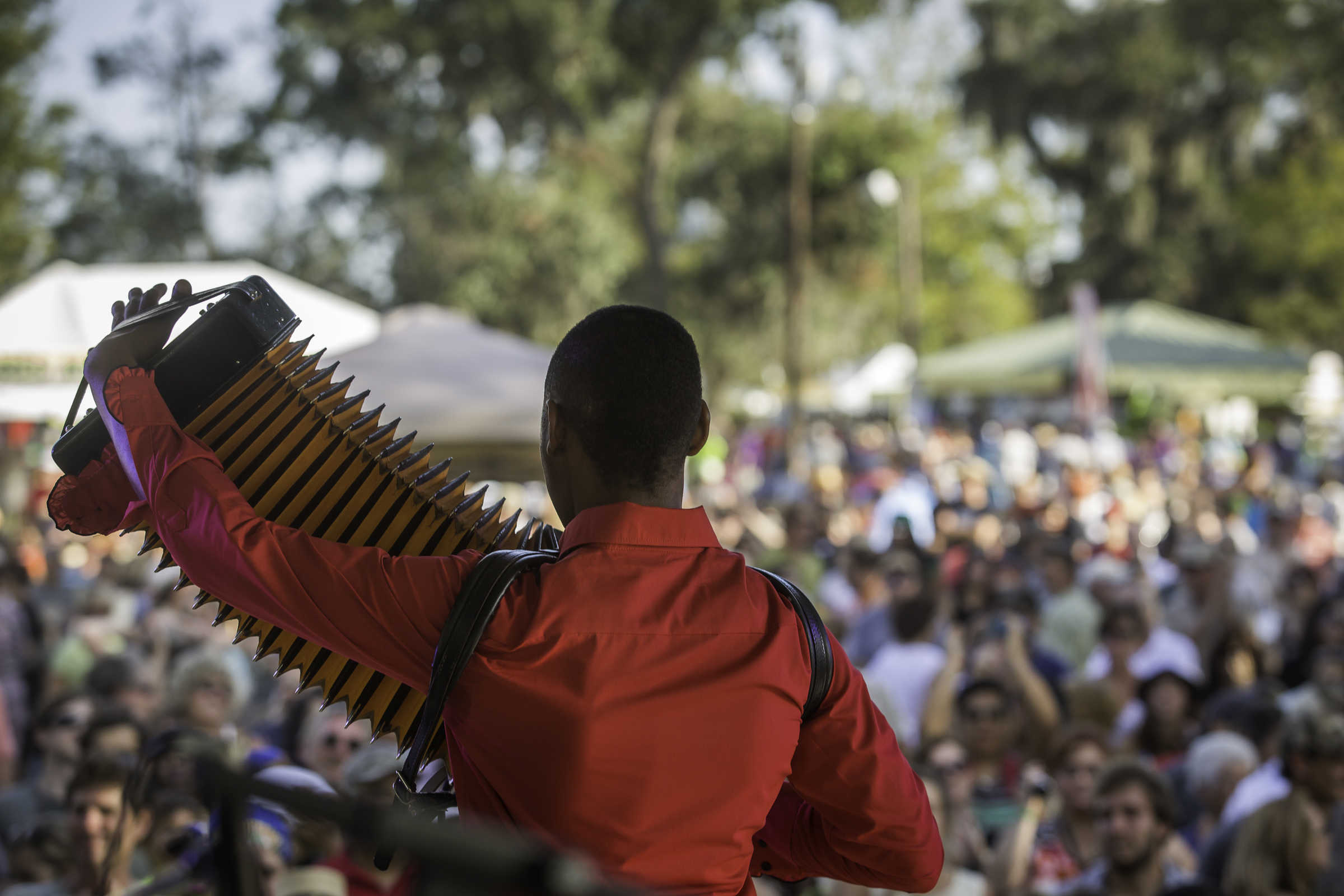 Young African American man playing accordion on stage in New Orleans