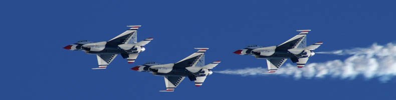 Three jets flying in blue skies