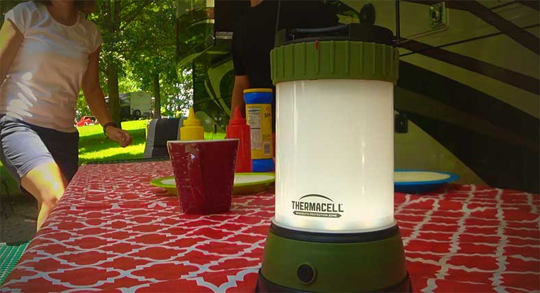 Thermacel L camping light on picnic bench with motorhome in background