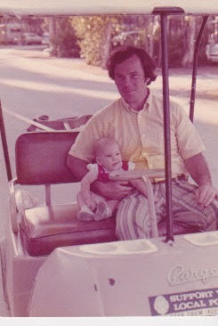 Woodsmoke Camping Resort - old photograph Dad and Daughter on golf cart