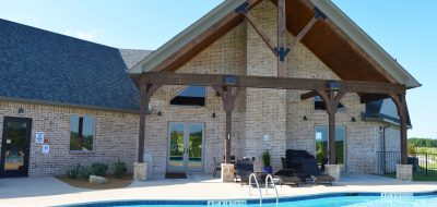 Nice RV Resort building in front of pool on sunny day