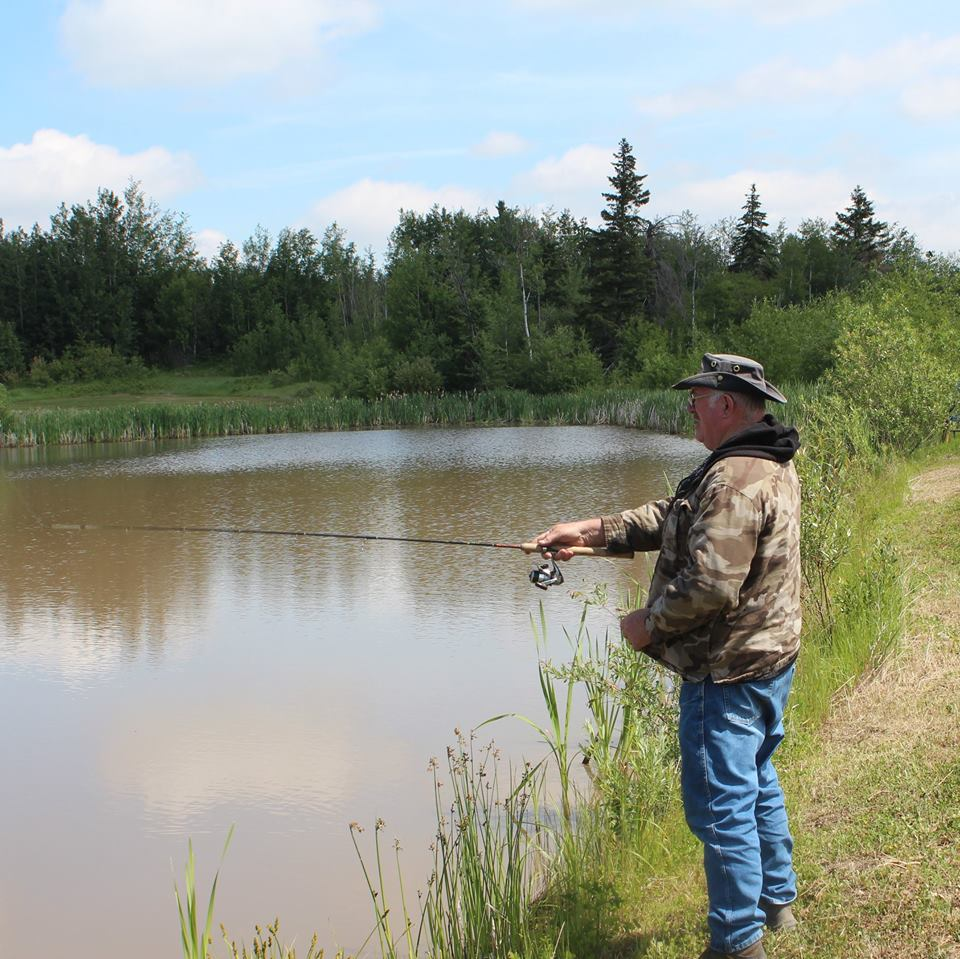 Memory Lane Campground and RV Park - man fishing