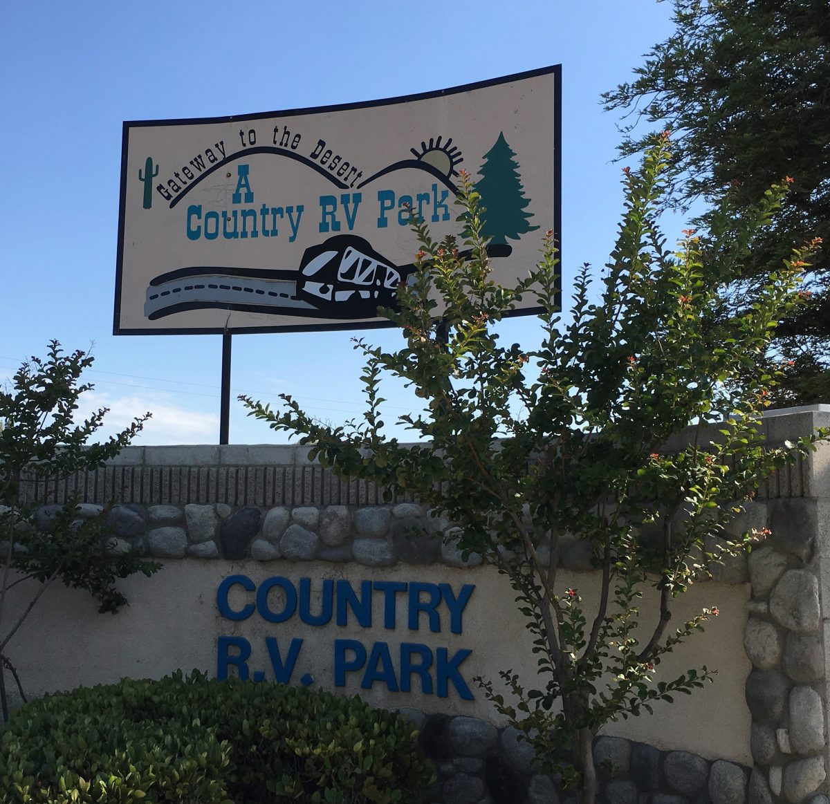 A Country RV Park - entrance sign