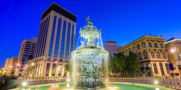 Montgomery, Alabama outdoor fountain lit up in front of buildings, at dusk