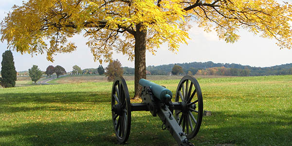 A cannon facing a vast field.
