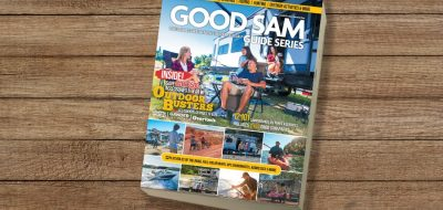 Good Sam Guide Series camping & RVing book on wooden table