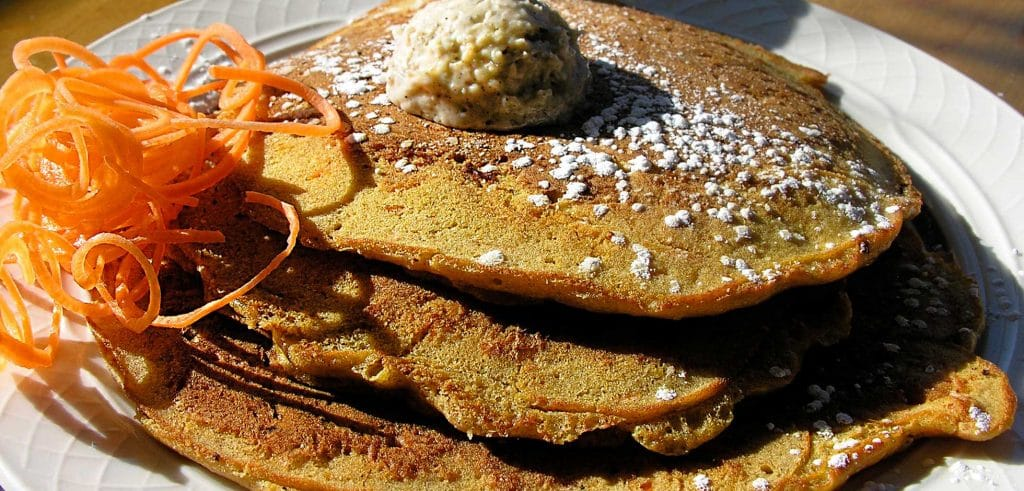 Carrot hot cakes with butter on top