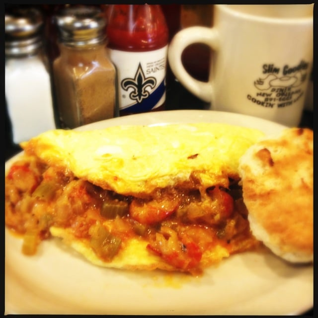 Omelet, folded over slim crawfish and salsa with salt and pepper shaker