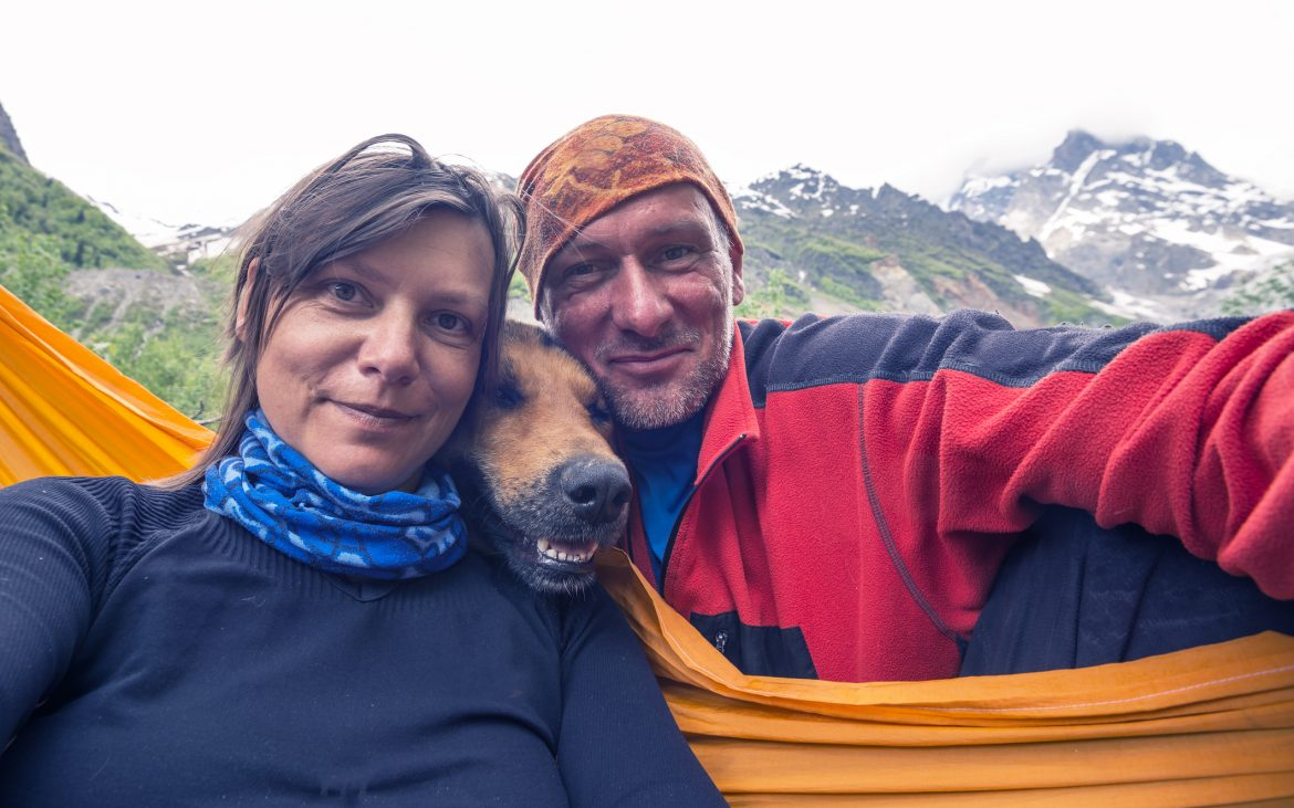 Man and woman smiling selfie with dog