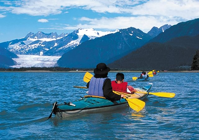 kayaking in alaska, boy and mom on kayak, snow on mountains