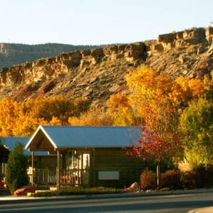 Beautiful cabin in fall tree setting for Zion RV Park