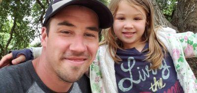 Author Jeremy P Elder and his daughter at Carpinteria State Beach, California