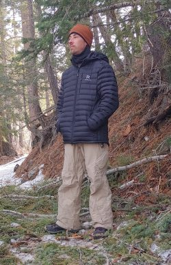 Author, podcast host, and public figure Jeremy P Elder in snowy woods.