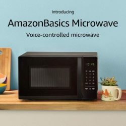 Amazon Basics Black Microwave with Amazon Alexa features sitting on countertop.