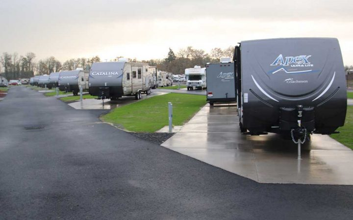 Multiple towables parked in RV spots at Guaranty RV Park