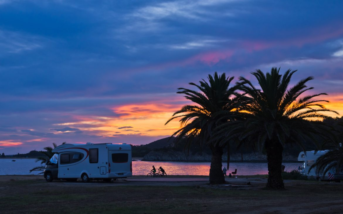 Camper at Sunset with kids playing