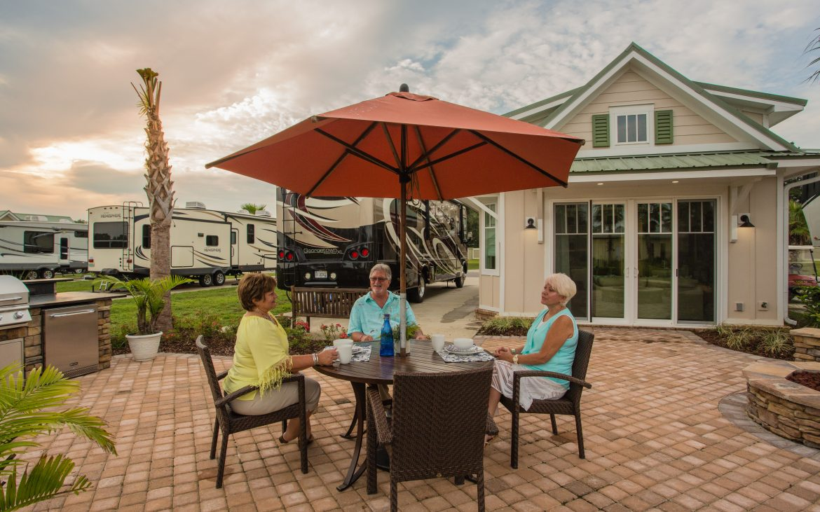 Elderly women sitting around a patio table at the Osprey RV Resort clubhouse