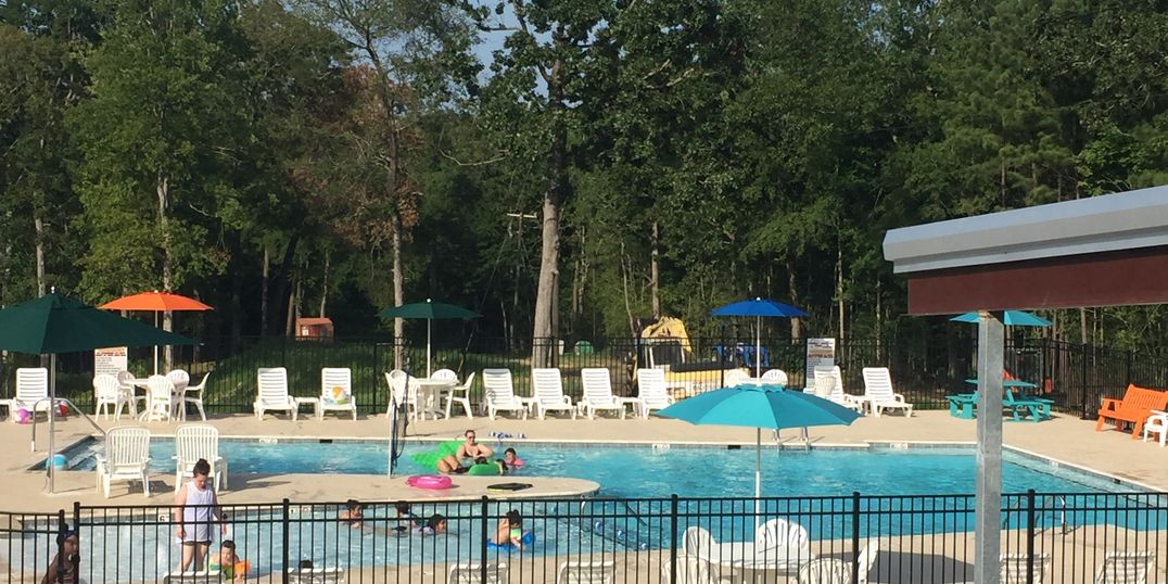 Campers enjoying community pool
