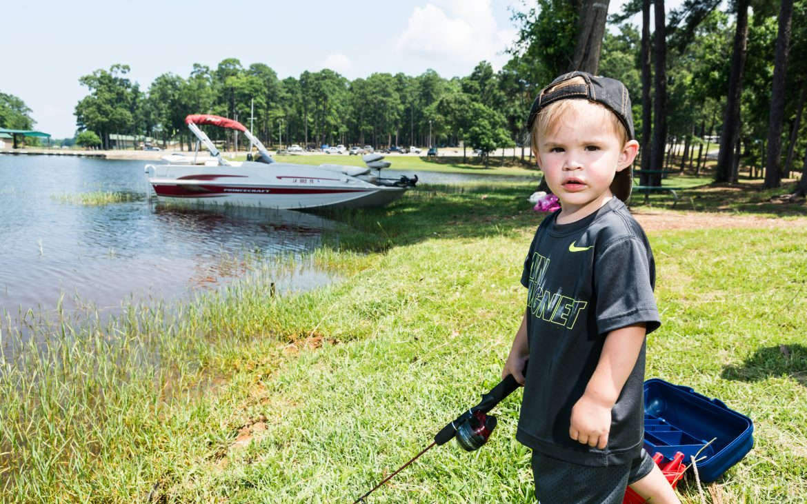 Young boy fishing during the day at Toledo Lake Louisiana