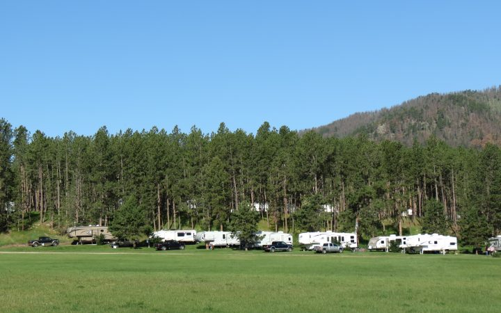 RVs parked at Rafter J Bar Resort during daytime