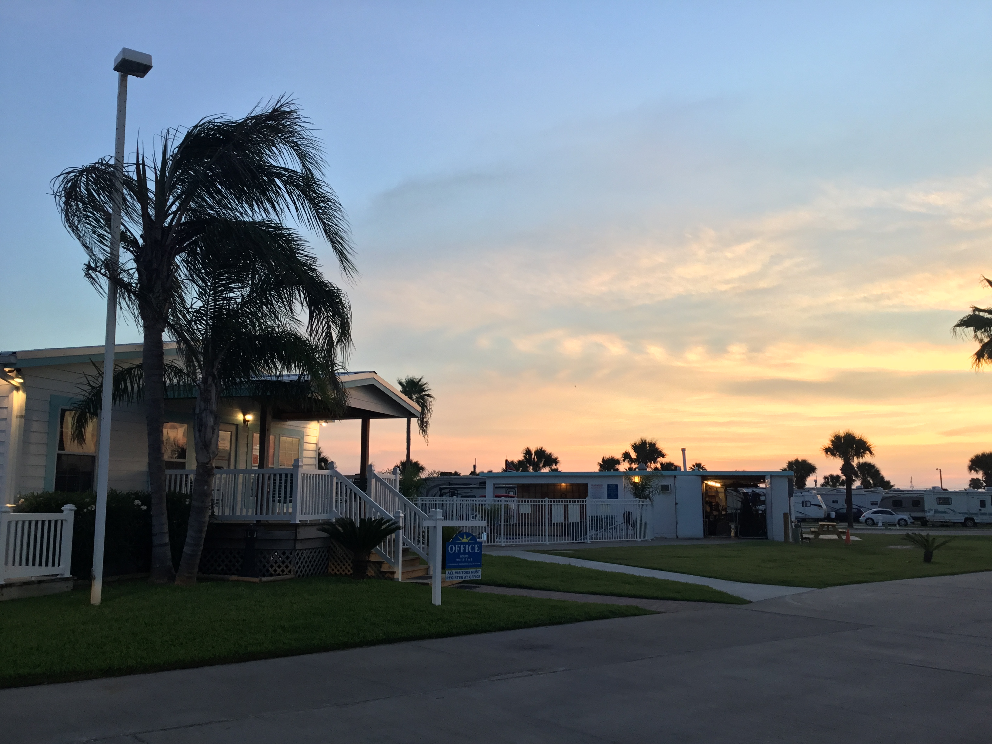 Sunset view of RV's parked at Island RV Resort in Texas