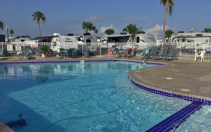 Beautiful clear pool at Island RV Resort with RVs in background