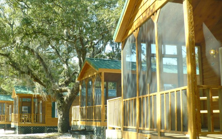 Daytime photo of the patios of several cabins at Rivers End Campground on Tybee Island Georgia