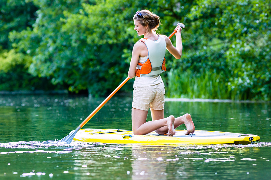 Woman on SUP with paddle