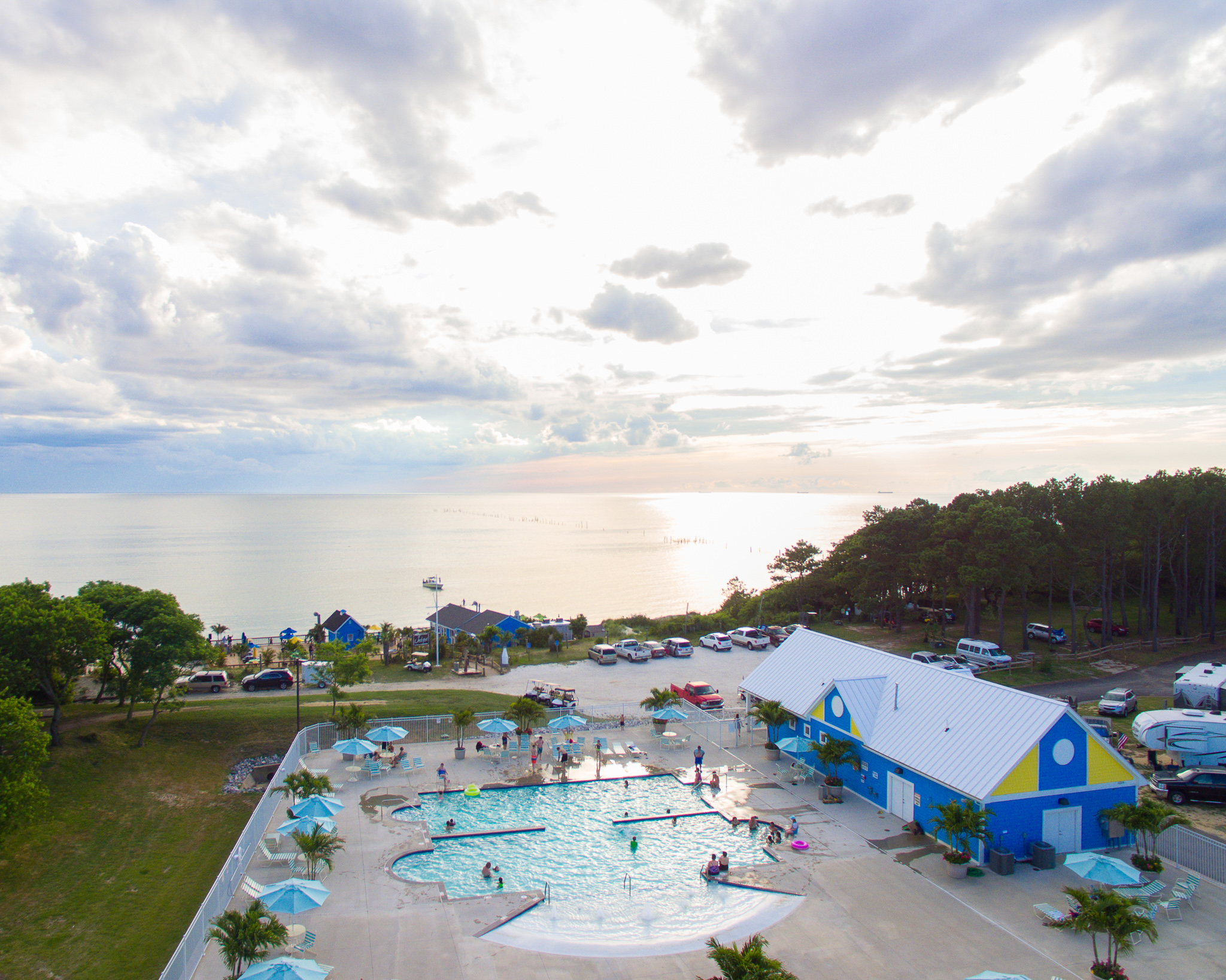 Gorgeous arial view of community pool with sunset in background