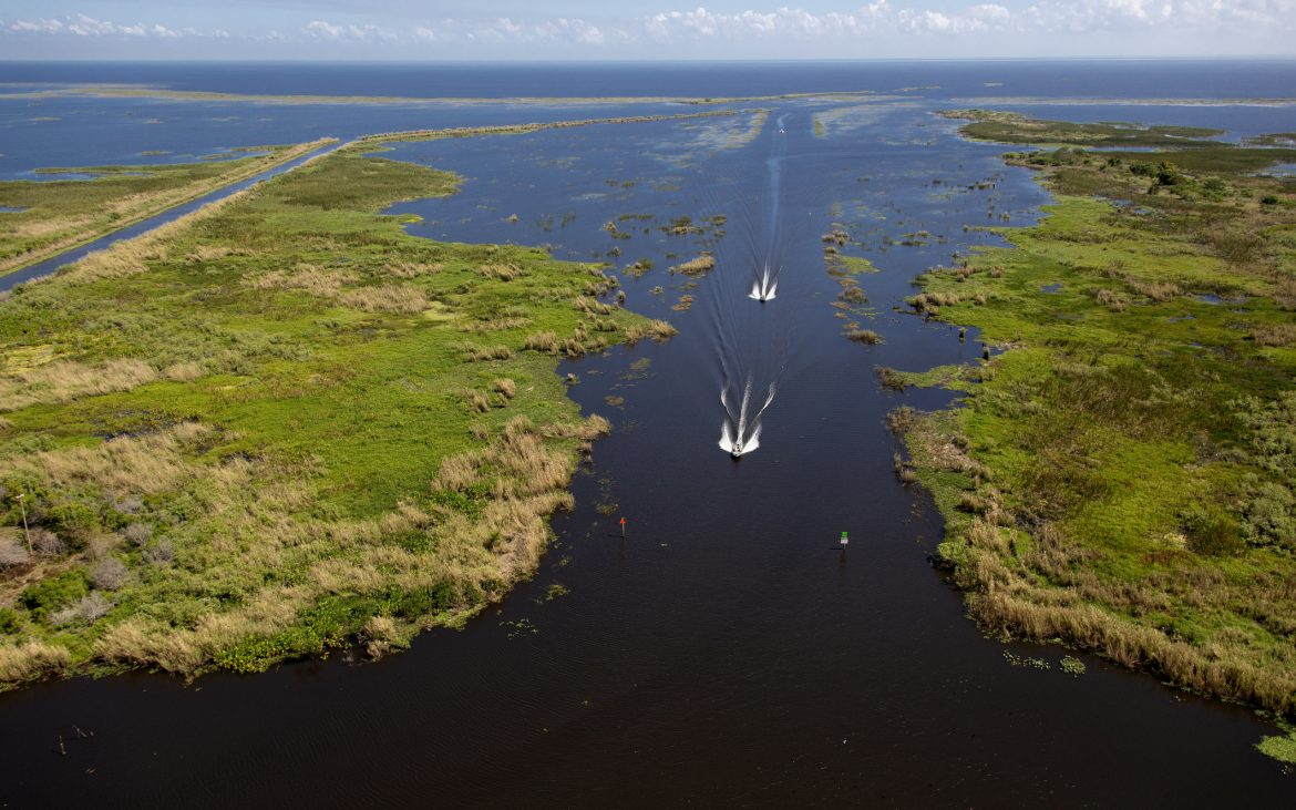 Aerial view of Lake Okeechobee with boats cruising on water