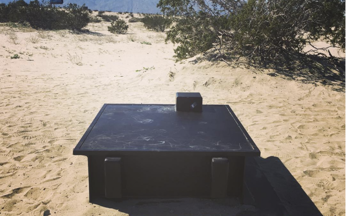 Black bunker in the Southern California desert sand