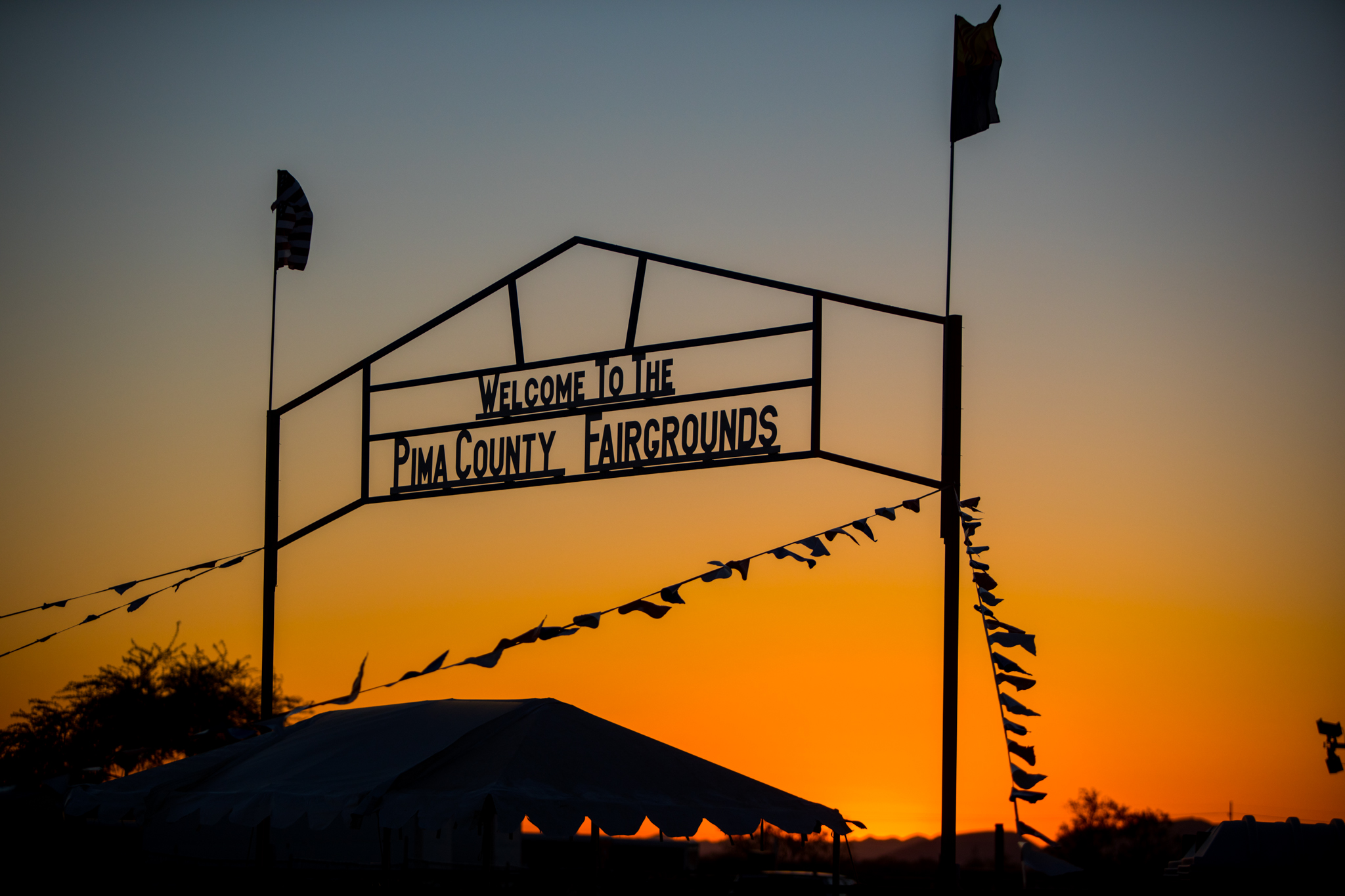 Sunsetting behind the Pima Fairgrounds Sign