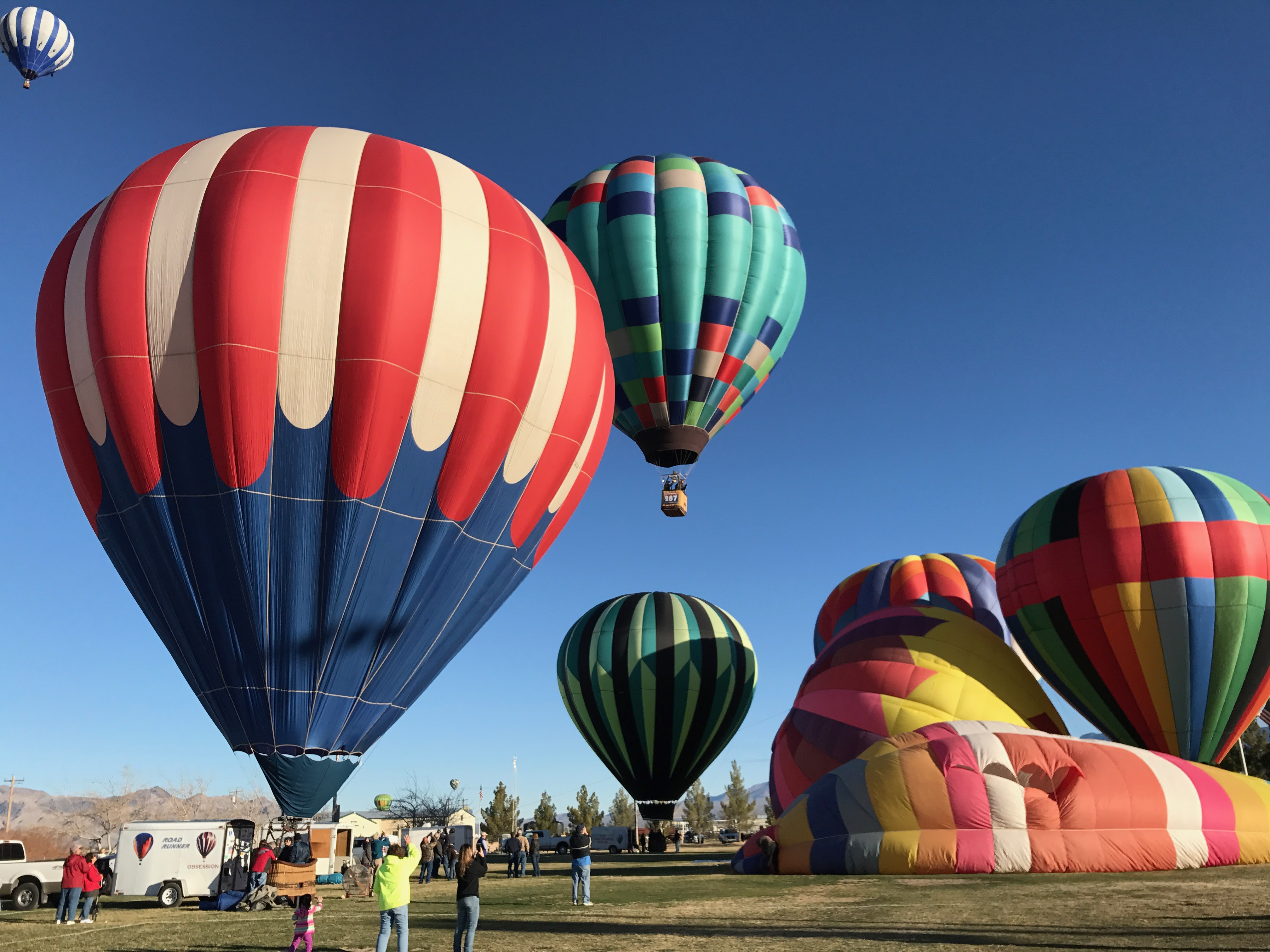 Many air balloons on the ground for the Pahrump Balloon Festival