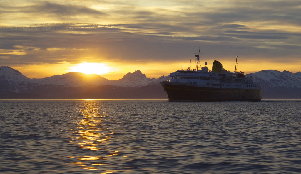 Cruise ship in the Alaskan water during the sunset