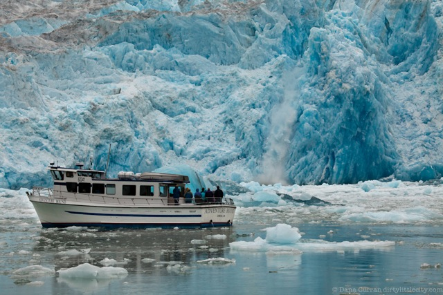 Tour boat in front of large glacier