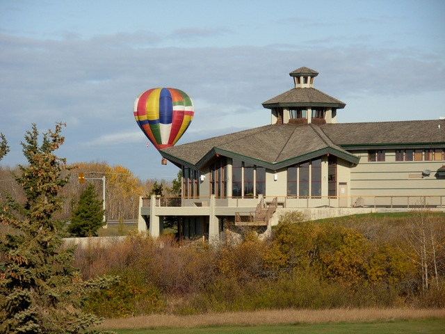 Clubhouse with colorful air balloon floating behind it.