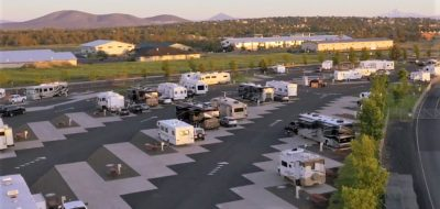 Aerial view of campground showing many RVs and trailers